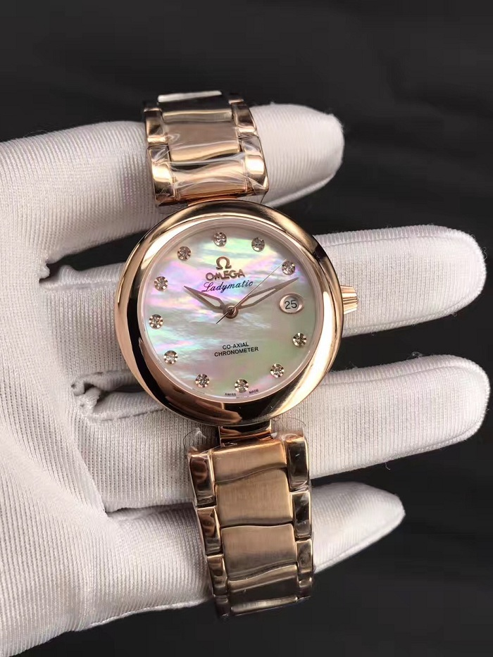 LADYMATIC OMEGA CO‑AXIAL 34 MM Sedna™ gold on Sedna™ gold 425.60.34.20.55.004