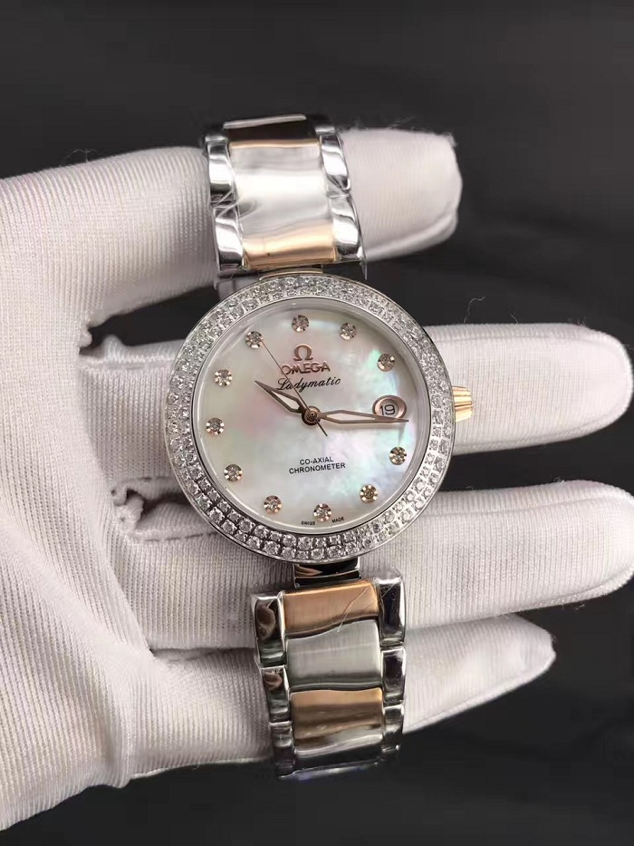 LADYMATIC OMEGA CO‑AXIAL 34 MM Steel Sedna™ Gold on Steel 425.25.34.20.55.004