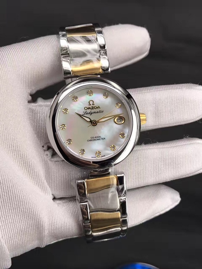 LADYMATIC OMEGA CO‑AXIAL 34 MM yellow gold on Steel 425.20.34.20.55.003